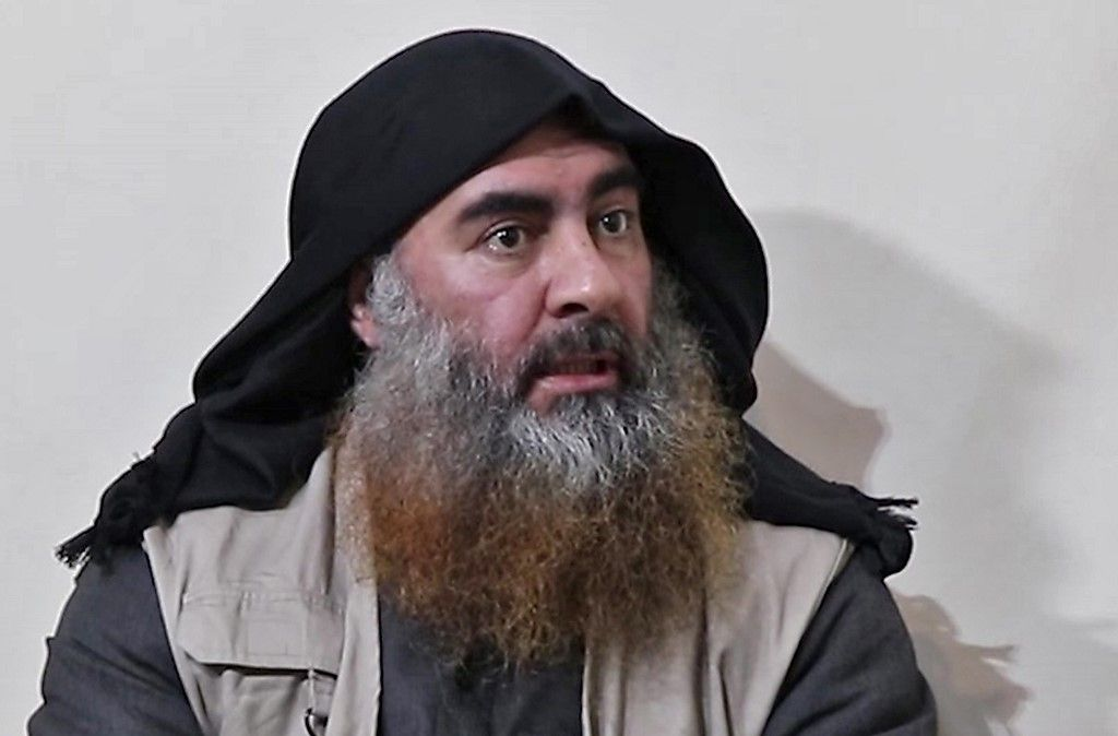 "(FILES) In this file photo taken on April 30, 2019 In this undated tv grab taken from a video released by Al-Furqan media, the chief of the Islamic State group Abu Bakr al-Baghdadi purportedly appears for the first time in five years in a propaganda video in an undisclosed location. - Baghdadi was believed to be dead after a US military raid in Syria's Idlib region, US media reported early on October 27, 2019. (Photo by - / various sources / AFP) / THIS PICTURE WAS MADE AVAILABLE BY A THIRD PARTY. AFP CAN NOT INDEPENDENTLY VERIFY THE AUTHENTICITY, LOCATION, DATE AND CONTENT OF THIS IMAGE. THIS PHOTO IS DISTRIBUTED EXACTLY AS RECEIVED BY AFP. RESTRICTED TO EDITORIAL USE - MANDATORY CREDIT ""AFP PHOTO / SOURCE / AL-FURQAN"" - NO MARKETING - NO ADVERTISING CAMPAIGNS - DISTRIBUTED AS A SERVICE TO CLIENTS / ALTERNATIVE CROP"