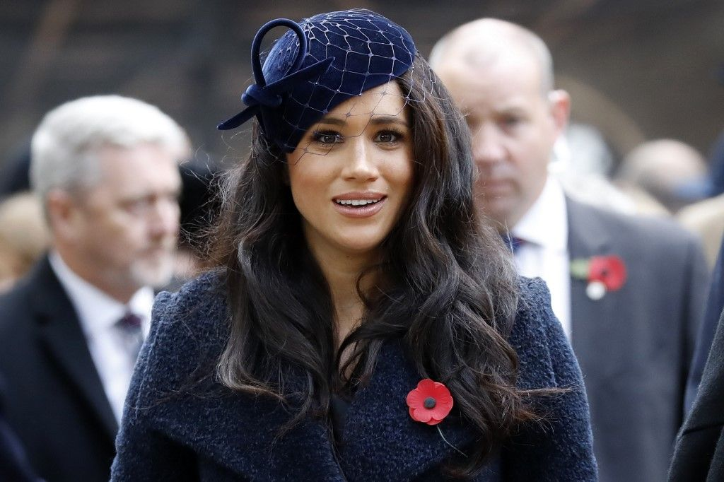 Meghan, Duchess of Sussex leaves after paying her respects during a visit to the Field of Remembrance at Westminster Abbey in central London on November 7, 2019. - The Field of Remembrance is organised by The Poppy Factory, and has been held in the grounds of Westminster Abbey since November 1928, when only two Remembrance Tribute Crosses were planted. In the run-up to Armistice Day, many Britons wear a paper red poppy -- symbolising the poppies which grew on French and Belgian battlefields during World War I -- in their lapels. (Photo by Tolga AKMEN / AFP)