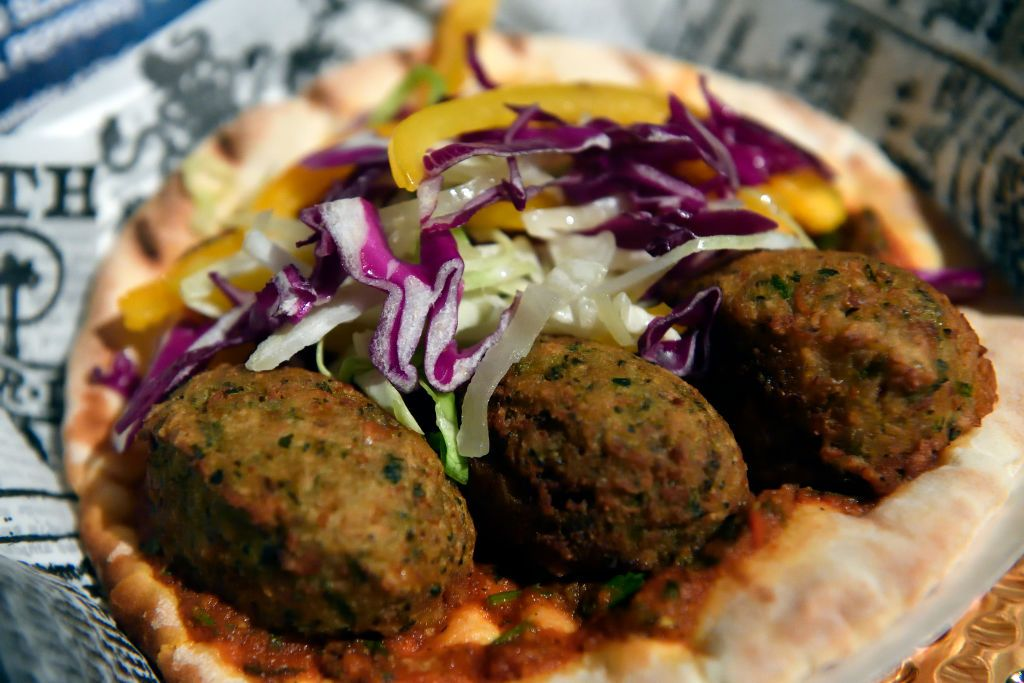 ANAHEIM, CA - MAY 17: Promising future falafel pita pickled red cabbage and bell peppers and charmoula sauce available at Studio Catering Truck inside Disney California Adventure Park is one of the new Summer of Heroes food in Anaheim, California, on Wednesday, May 17, 2017.     The ride, similar to The Twilight Zone Tower of Terror it replaced, gives the riders a sensation of free-falling as they site in a vehicles that drop randomly while doors open with new visual effects from the Guardians of the Galaxy universe.       (Photo by Jeff Gritchen/Digital First Media/Orange County Register via Getty Images)