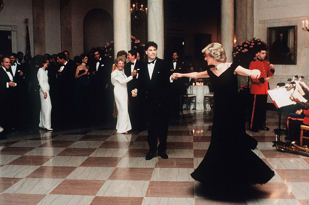 WASHINGTON, UNITED STATES - NOVEMBER 09: (FILE PHOTO) Diana, Princess Of Wales, watched by President Ronald Reagan and wife Nancy, dances with John Travolta at the White House, USA on November 9, 1985. Diana is wearing a midnight blue velvet dress by designer Victor Edelstein. (Photo by Anwar Hussein/WireImage) On July 1st Diana, Princess Of Wales would have celebrated her 50th Birthday Please refer to the following profile on Getty Images Archival for further imagery. http://www.gettyimages.co.uk/Search/Search.aspx?EventId=107811125&EditorialProduct=Archival For further images see also: Princess Diana: http://www.gettyimages.co.uk/Account/MediaBin/LightboxDetail.aspx?Id=17267941&MediaBinUserId=5317233 Following Diana's Death: http://www.gettyimages.co.uk/Account/MediaBin/LightboxDetail.aspx?Id=18894787&MediaBinUserId=5317233 Princess Diana - A Style Icon: http://www.gettyimages.co.uk/Account/MediaBin/LightboxDetail.aspx?Id=18253159&MediaBinUserId=5317233