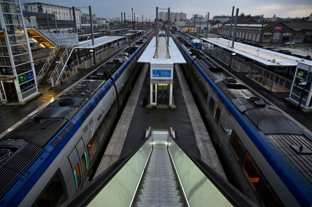 TER (Transport Express Regional) trains are pictured at Rennes railway station on December 9, 2019. - French commuters and tourists braced for a fifth day of public transport chaos Monday as the government prepared to respond to widespread anger over pension reform that has sparked open-ended walkouts. (Photo by Damien MEYER / AFP)