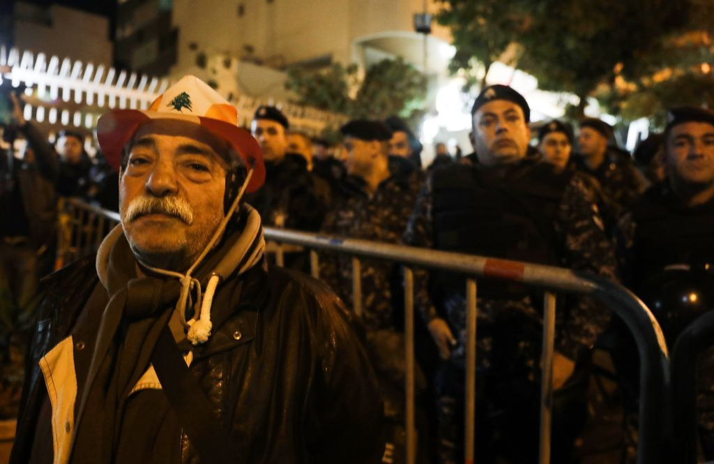 An elderly man takes part in a protest outside the house of Lebanon's new prime minister in the capital Beirut, calling for his resignation less than 10 days after he was appointed, on December 28, 2019. - Protests continued after the resignation of the previous prime minister, while political parties negotiated for weeks before nominating Hassan Diab, a professor and former education minister, to replace him on December 19. (Photo by ANWAR AMRO / AFP)