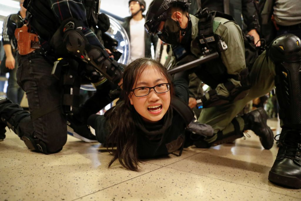 Police officers detain an anti-government protester during a demonstration inside a mall in Hong Kong, China December 15, 2019. REUTERS/Danish Siddiqui