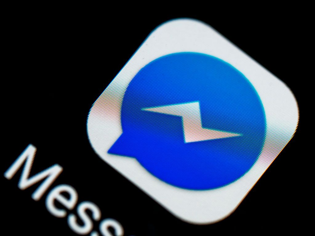 KIEV, UKRAINE - 2018/08/31:  In this photo illustration, the Facebook Messenger logo seen displayed on a smartphone. (Photo Illustration by Igor Golovniov/SOPA Images/LightRocket via Getty Images)