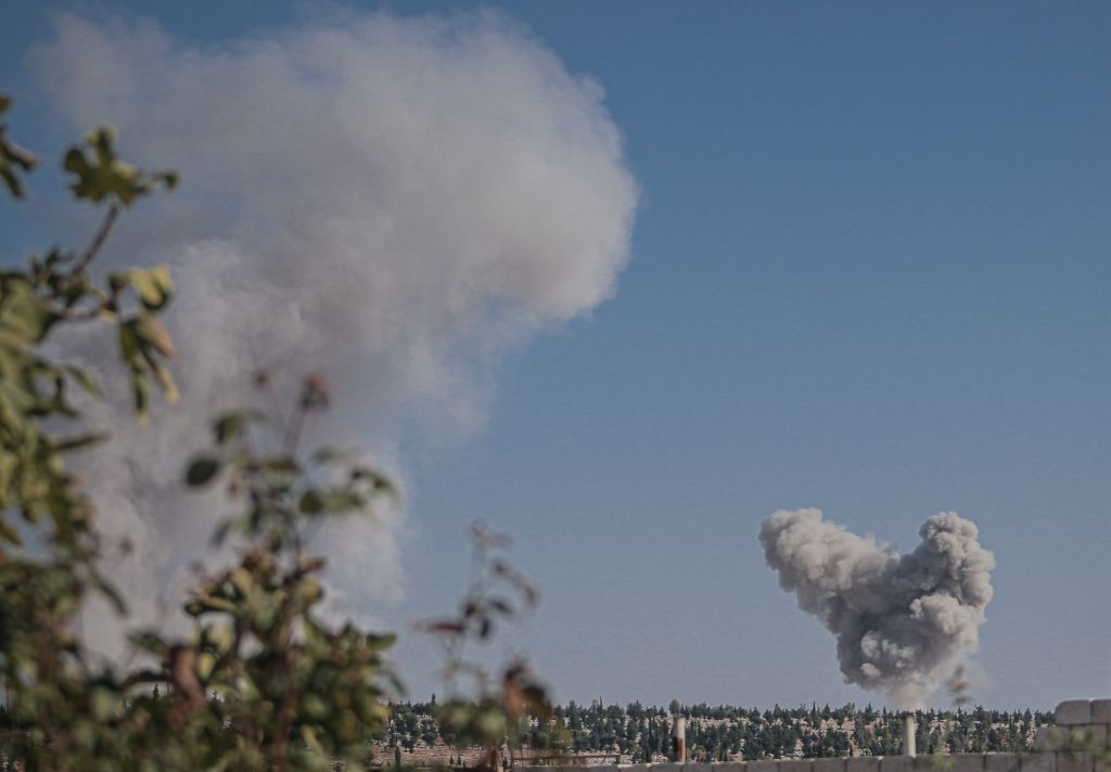 IDLIB, SYRIA - NOVEMBER 20 : Smoke rises after an area is hit in Kafr Nabl district in Idlib, Syria on November 20, 2019 after Assad regime and Russia's move to infiltrate the frontline of armed opposition military groups in southern Idlib.