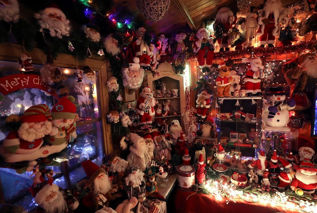 "Christmas decorations are seen in Serge Hennebel's, nicknamed ""Elf Serge"", garden, which has been transformed into a Christmas village and adorned with hundreds of lights, in Hamme-Mille, Belgium December 7, 2019  REUTERS/Yves Herman"