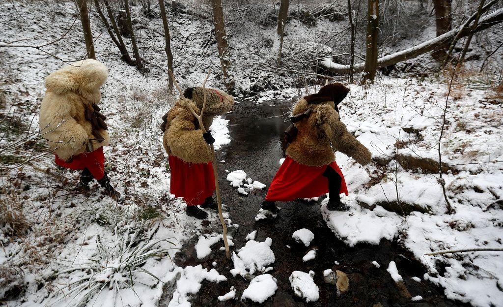 Revellers dressed as devils walk through the village of Valasska Polanka during a traditional Saint Nicholas parade near the town of Vsetin, Czech Republic, December 7, 2019. REUTERS/David W Cerny