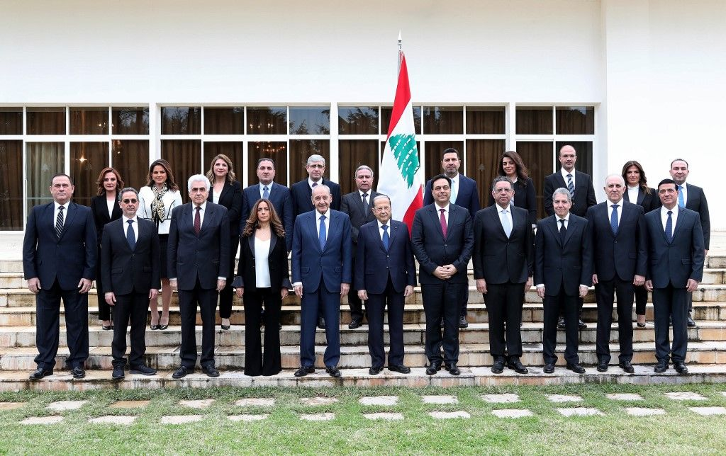 A handout picture provided by the Lebanese photo agency Dalati and Nohra shows Lebanon's Parliament Speaker Nabih Berri (C-L) and President Michel Aoun (C) and prime minister designa...</p>                     </div>                     <div class=
