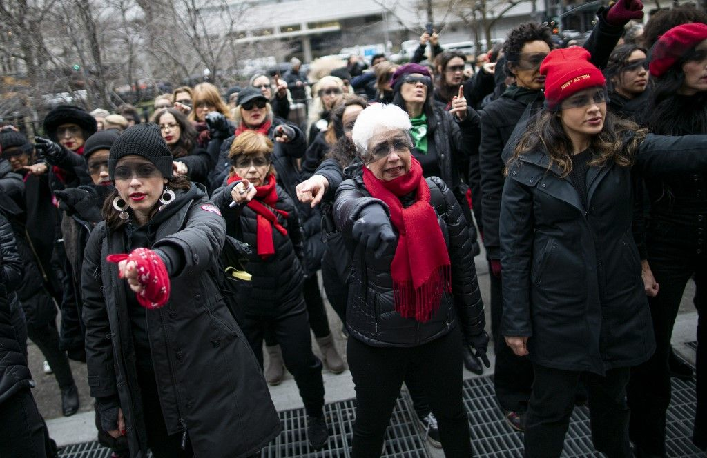 NEW YORK, NY - JANUARY 10: Women protest against rape as they sing a song in front of the court while Harvey Weinstein attends a pretrial session on January 10, 2020 in New York City. Weinstein, a movie producer whose alleged sexual misconduct helped spark the #MeToo movement, pleaded not-guilty on five counts of rape and sexual assault against two unnamed women and faces a possible life sentence in prison.   Kena Betancur/Getty Images/AFP