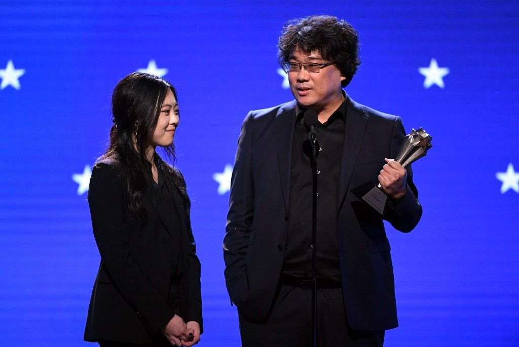 SANTA MONICA, CALIFORNIA - JANUARY 12: (L-R) Interpreter Sharon Choi and director Bong Joon-ho accept the Best Director award for 'Parasite' onstage during the 25th Annual Critics' Choice Awards at Barker Hangar on January 12, 2020 in Santa Monica, California.   Kevin Winter/Getty Images for Critics Choice Association/AFP
