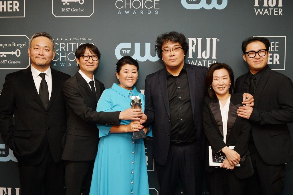 "SANTA MONICA, CALIFORNIA - JANUARY 12: Winners of Best Foreign Language Film award for ""Parasite"" (L-R) Ha-jun Lee, Yang Jin-mo, Lee Jung-eun, Bong Joon-ho, Kwak Sin-ae and Jin Won Han pose in the press room during the 25th Annual Critics' Choice Awards at Barker Hangar on January 12, 2020 in Santa Monica, California.   Matt Winkelmeyer/Getty Images for Critics Choice Association/AFP"
