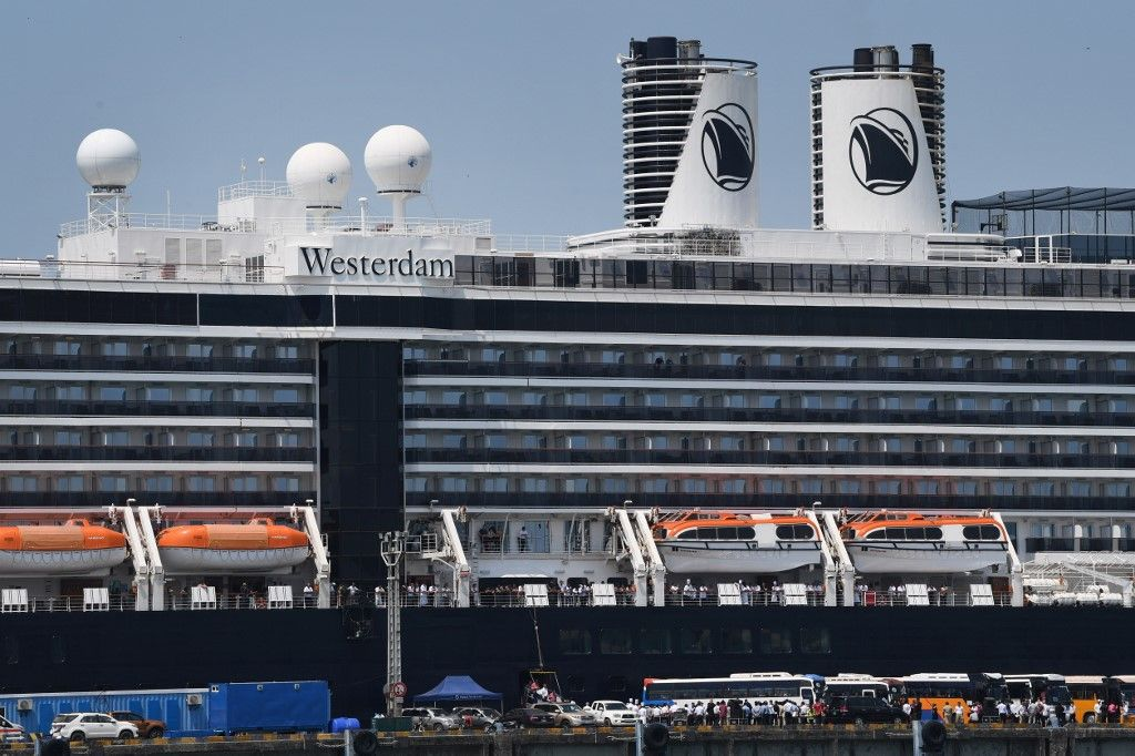 Passengers disembark from the Westerdam cruise ship in Sihanoukville on February 19, 2020. - Dozens of passengers stuck for nearly a week on a US cruise ship in Cambodia disembarked on February 19, after being given the all-clear from the deadly COVID-19 novel coronavirus. (Photo by TANG CHHIN Sothy / AFP)