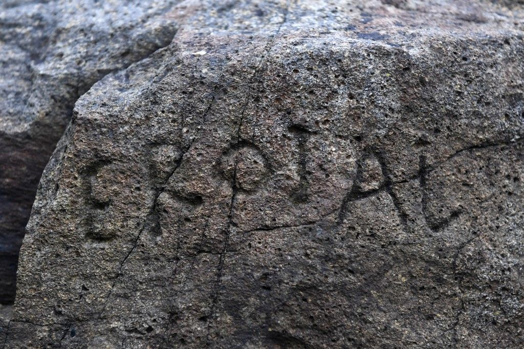 This picture taken on February 24, 2020 shows an inscription on a rock in Plougastel-Daaoulas, western France. - The mysterious inscription engraved almost 250 years ago on a rock in Plougastel-Daoulas (Finistere) was finally able to be unscrambled thanks to the competition, relayed by the media from around the world, launched by the small town last May. (Photo by Fred TANNEAU / AFP)