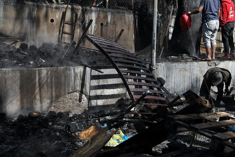 A burnt bed is seen following a fire in containers used to house refugees and migrants in the Moria camp on the island of Lesbos, Greece, March 16, 2020. REUTERS/Elias Marcou