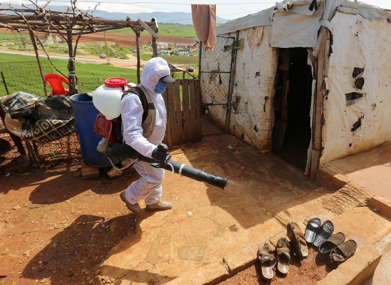 FILE PHOTO: A worker from the municipality sanitizes Syrian refugee camp, as Lebanon extends a lockdown by two weeks to combat the spread of coronavirus disease (COVID-19) in Marjayoun, Lebanon March 23, 2020. Picture taken March 23, 2020. REUTERS/Aziz Taher/File Photo