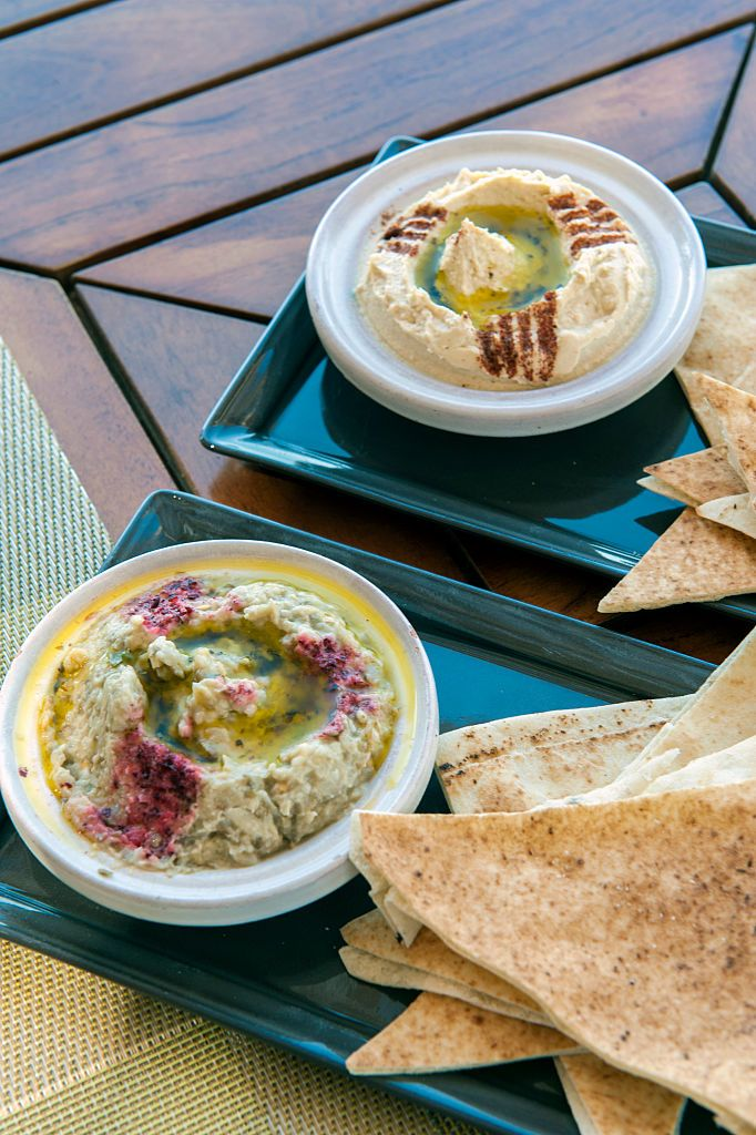 SIR BANI YAS, ABU DHABI, UNITED ARAB EMIRATES - 2013/10/23: Hummus and mutabbal, eggplant dip, at Amwaj restaurant at the Anantara Desert Islands on Sir Bani Yas, an island in the Persian Gulf, and once the private retreat of the United Arab Emirates founder, the former Sheikh Zayed Bin Sultan Al Nahyan. The Bangkok based Anantara group run three resorts on the island. The first, Desert Islands, opened in one of the royal palaces former guest houses in 2008. (Photo by Leisa Tyler/LightRocket via Getty Images)