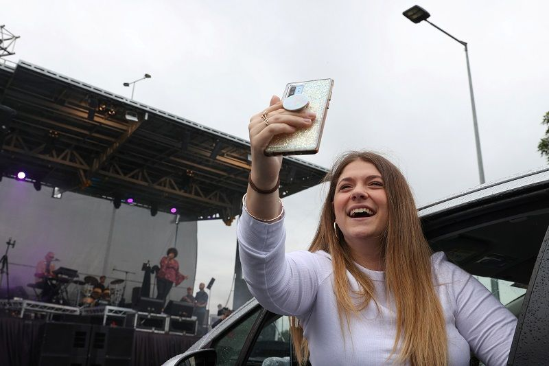 An audience member enjoys a drive-in concert organised to allow people to experience live music while observing the coronavirus...</p>                     </div>                     <div class=