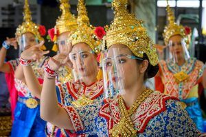 Traditional Thai dancers wearing protective face shields perform at the Erawan Shrine, which was reopened after the Thai government relaxed measures to combat the spread of the COVID-19 novel coronavirus, in Bangkok on May 4, 2020. - ...</p>                     </div>                     <div class=