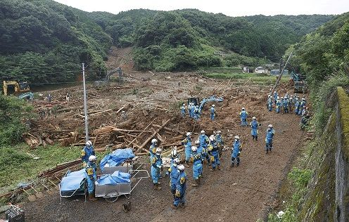 Police officers search for missing people at a landslide site caused by a heavy rain in Tsunagi town, Kumamoto prefecture, southern Japan, in this photo taken by Kyodo July 5, 2020. Mandatory credit Kyodo/via REUTERS ATTENTION EDITORS - THIS IMAGE WAS PROVIDED BY A THIRD PARTY. MANDATORY CREDIT. JAPAN OUT. NO COMMERCIAL OR EDITORIAL SALES IN JAPAN.