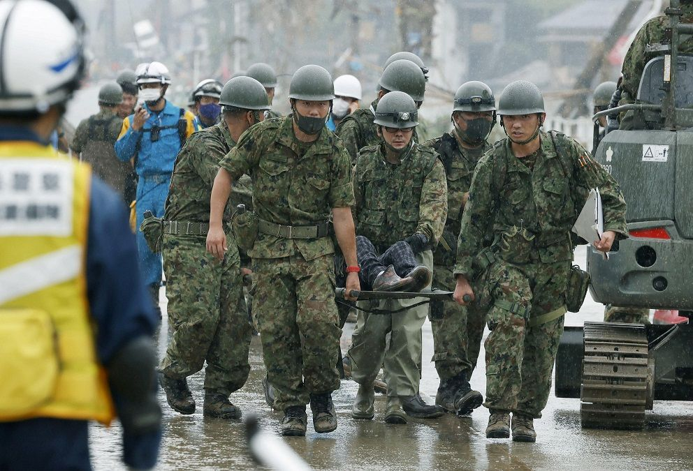 Japanese Self-Defence Force soldiers carry rescured person using a stretcher at a flooding site caused by a heavy rain in Kuma village, Kumamoto prefecture, southern Japan, in this photo taken by Kyodo July 5, 2020. Mandatory credit Kyodo/via REUTERS ATTENTION EDITORS - THIS IMAGE WAS PROVIDED BY A THIRD PARTY. MANDATORY CREDIT. JAPAN OUT. NO COMMERCIAL OR EDITORIAL SALES IN JAPAN.