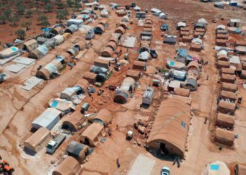 This picture taken on July 11, 2020 shows an aerial view of a camp for displaced Syrians from Idlib and Aleppo provinces, near the town of Maaret Misrin in Syria's northwestern Idlib province. - The Idlib region, Syria's last major opposition bastion, is home to some three million people, nearly half of whom have been displaced from other regions. (Photo by OMAR HAJ KADOUR / AFP)