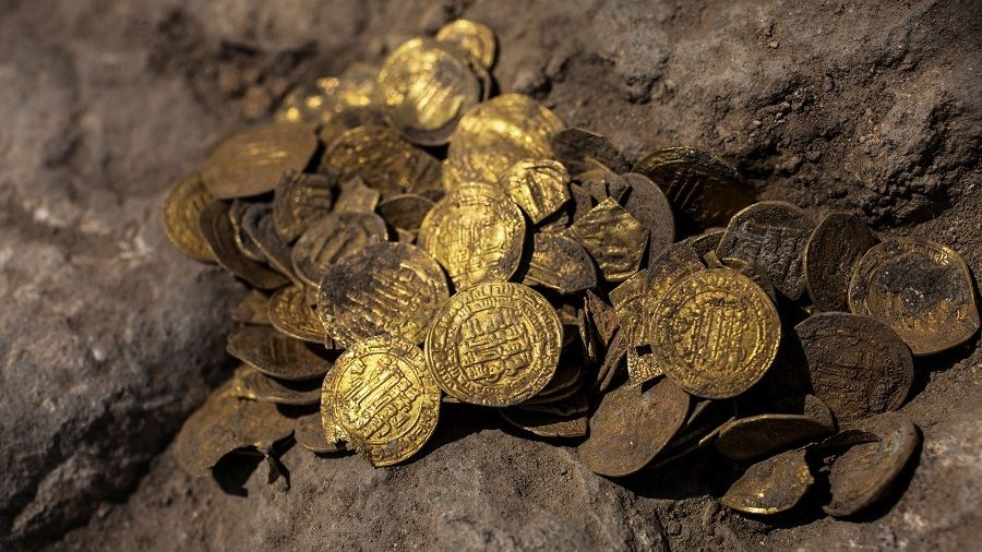 A hoard of gold coins, said by the Israel Antiquities Authority to date to the Abbasid dynasty, is seen after its discovery at an archaeological site in Central Israel August 18, 2020. Picture taken August 18, 2020. Heidi Levine/Pool via REUTERS