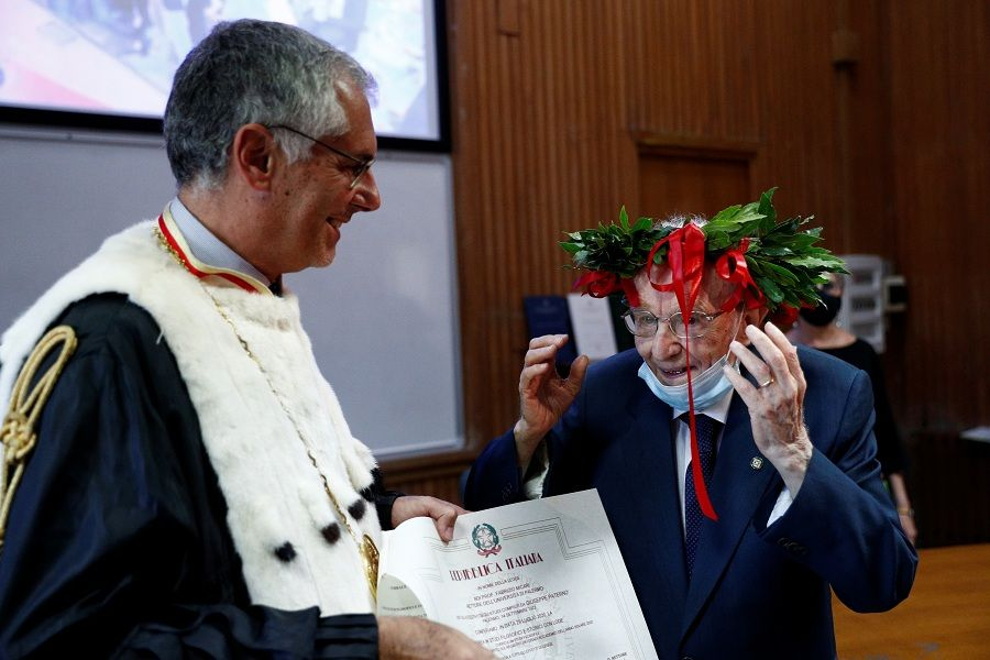 "Giuseppe Paterno, 96, Italy's oldest student, is awarded his graduation certificate after completing his undergraduate degree in history and philosophy, during his graduation at the University of Palermo, in Palermo, Italy, July 29, 2020. REUTERS/Guglielmo Mangiapane     SEARCH ""ITALY'S OLDEST STUDENT"" FOR THIS STORY. SEARCH ""WIDER IMAGE"" FOR ALL STORIES."