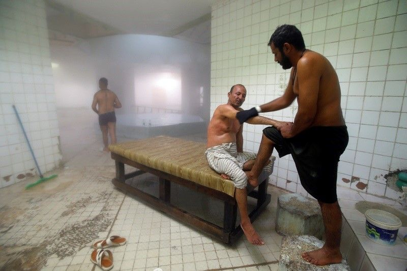 العراق.. المواطنون يغامرون بالتردد على حمّامات البخار العامة رغم كورونا